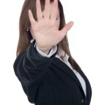 businesswoman gesturing stop