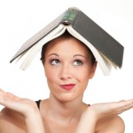 confused woman with book on head