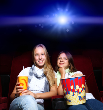 two young girls in cinema - how to upload a video to youtube